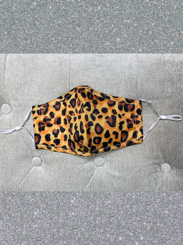 leopard print face mask with filter adjustable straps and metal at nose | shop women's clothing clothes apparel accessories and gifts online or in store at boerne pixie boutique | a favorite of locals and san antonio visitors too
