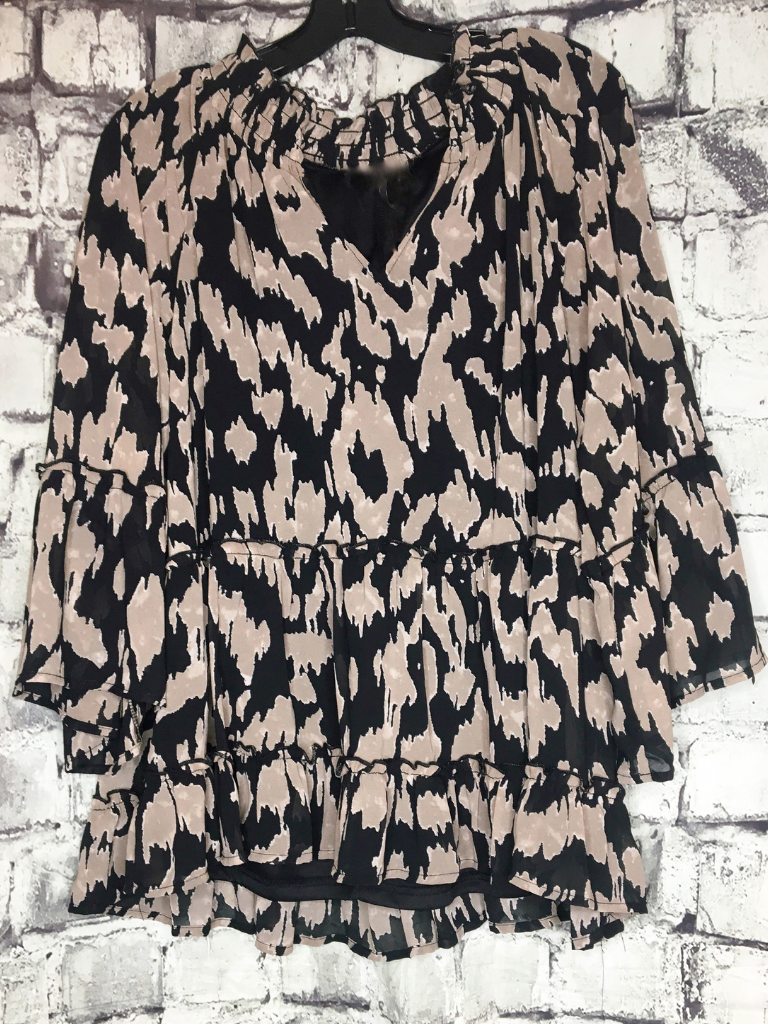 leopard print top with bell ruffle sleeves and ruffled hem | shop women's clothing clothes apparel accessories jewelry and gifts online or in store at boerne pixie boutique | a favorite of locals and san antonio visitors too | top best boerne boutiques