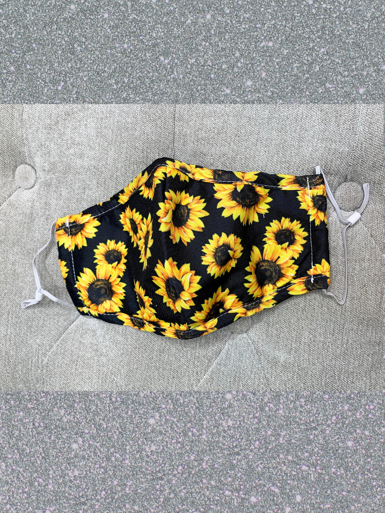 black and yellow sunflower face mask with nose pinch and filter slot | shop women's clothing clothes apparel accessories and gifts online or in store at boerne pixie boutique | a favorite of locals and san antonio visitors too