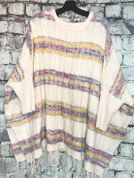 cream white yellow blue pink multicolor striped sweater poncho top shirt blouse with fringe | fall and winter fashion | shop women's clothing clothes apparel accessories jewelry and gifts online or in store at boerne pixie boutique | a favorite of locals and san antonio visitors too