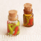 miniature pickled chili bottles
