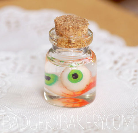 2 eyeballs specimen jar, green