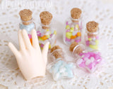 miniature jelly bean bottles with Minifee hand
