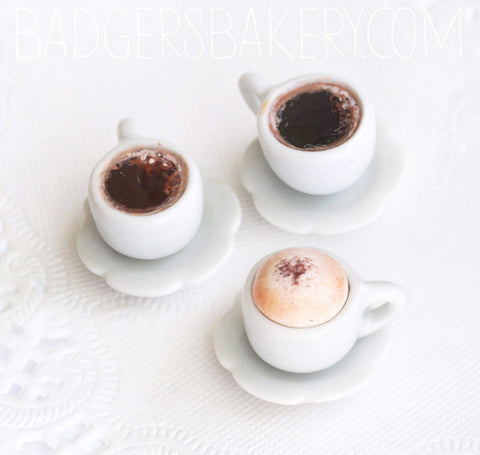 miniature coffee cups, black and cappuccino
