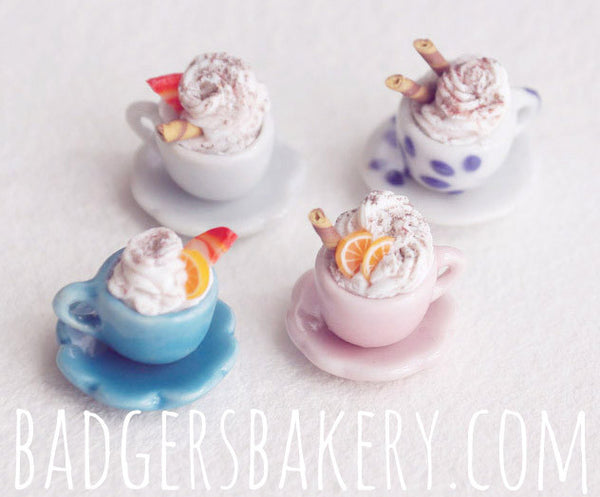 miniature coffee cups (white, patterned white, blue, pink)
