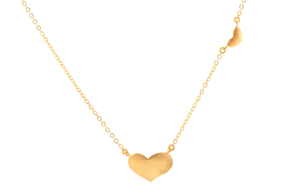 22KT Gold plated Solid Heart Necklace that sits asymmetrically form the Bleeding Hearts Collection