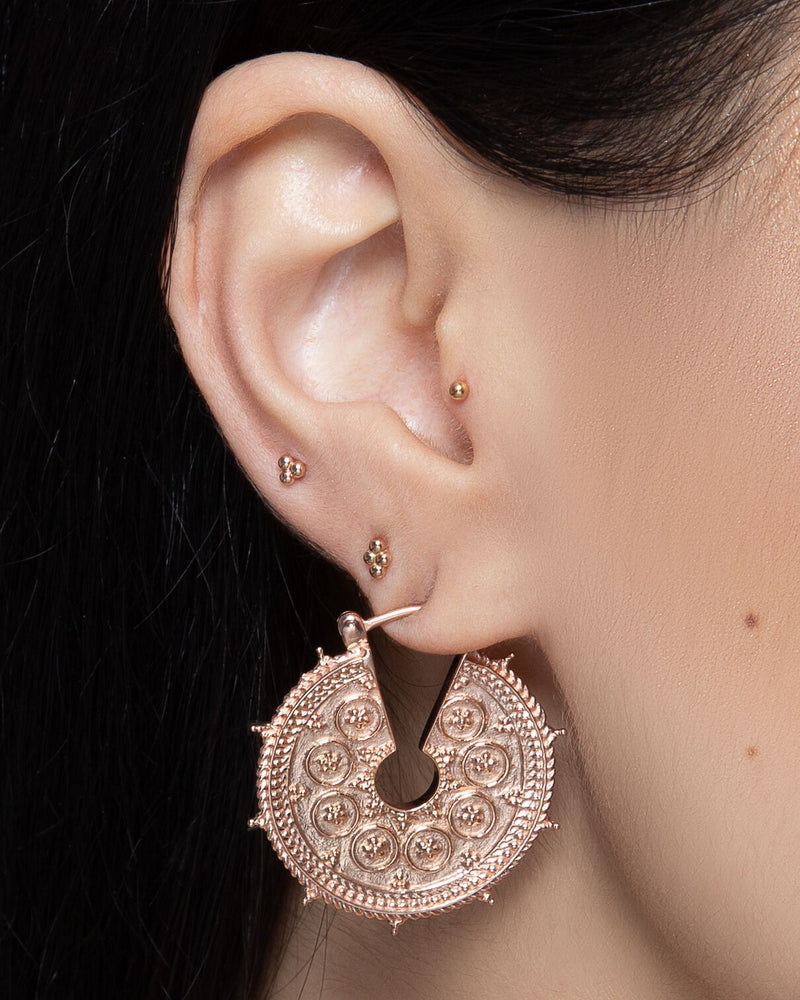 Ear piercings with cluster collection