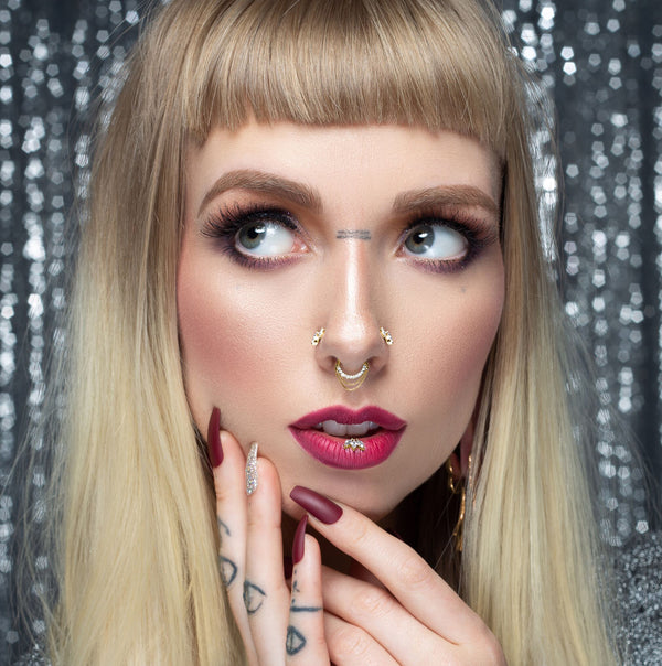 Model with Tempest Diamond clicker in septum piercing