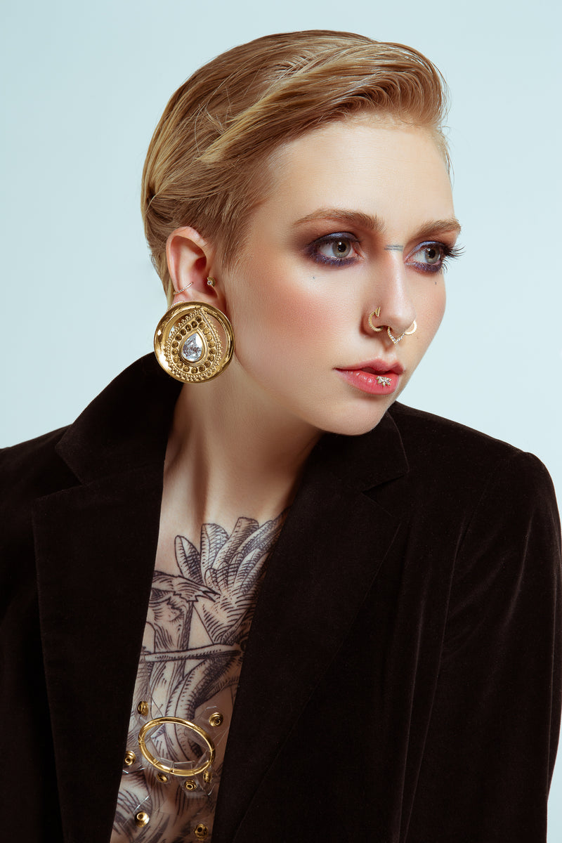 Model wearing Deity round in yellow gold
