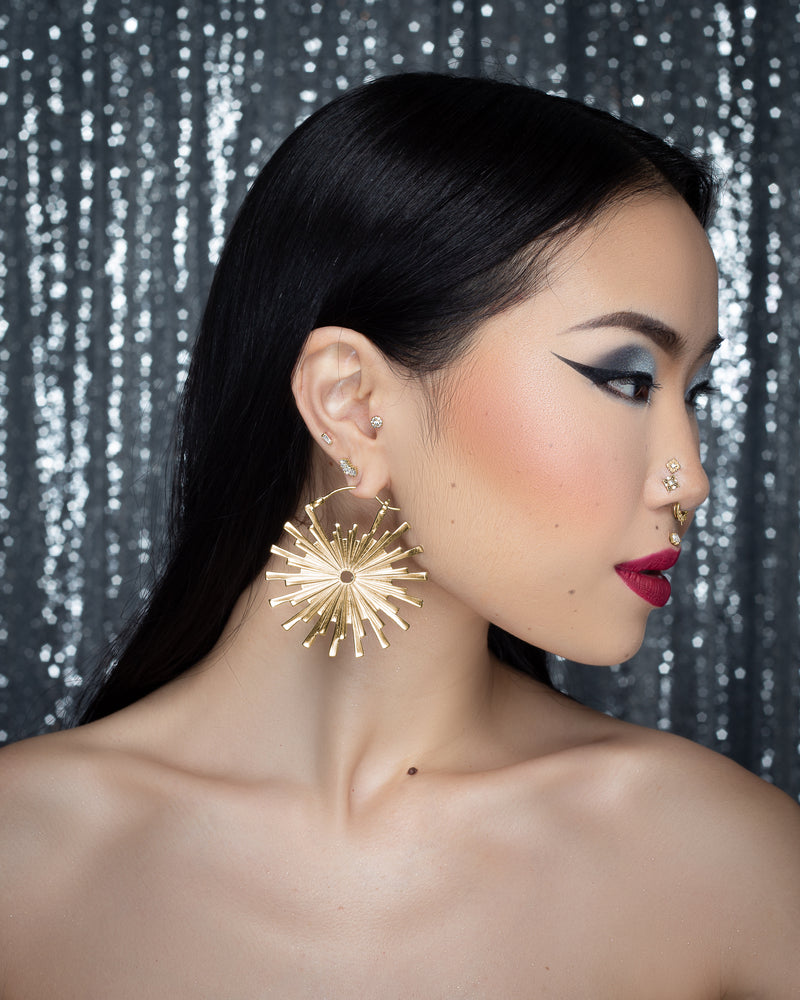 Model wearing large Galaxy Earrings - Yellow Gold Plated
