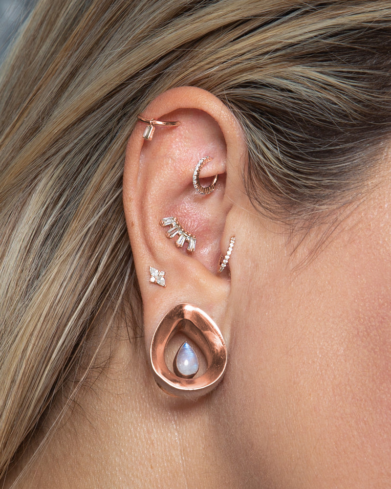 Curated ear featuring madeline charm