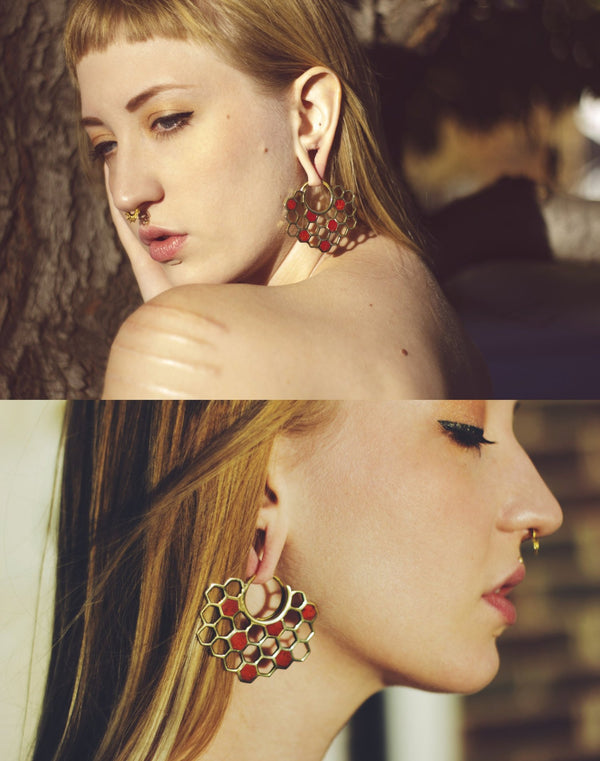 Model in Buzz earrings in brass