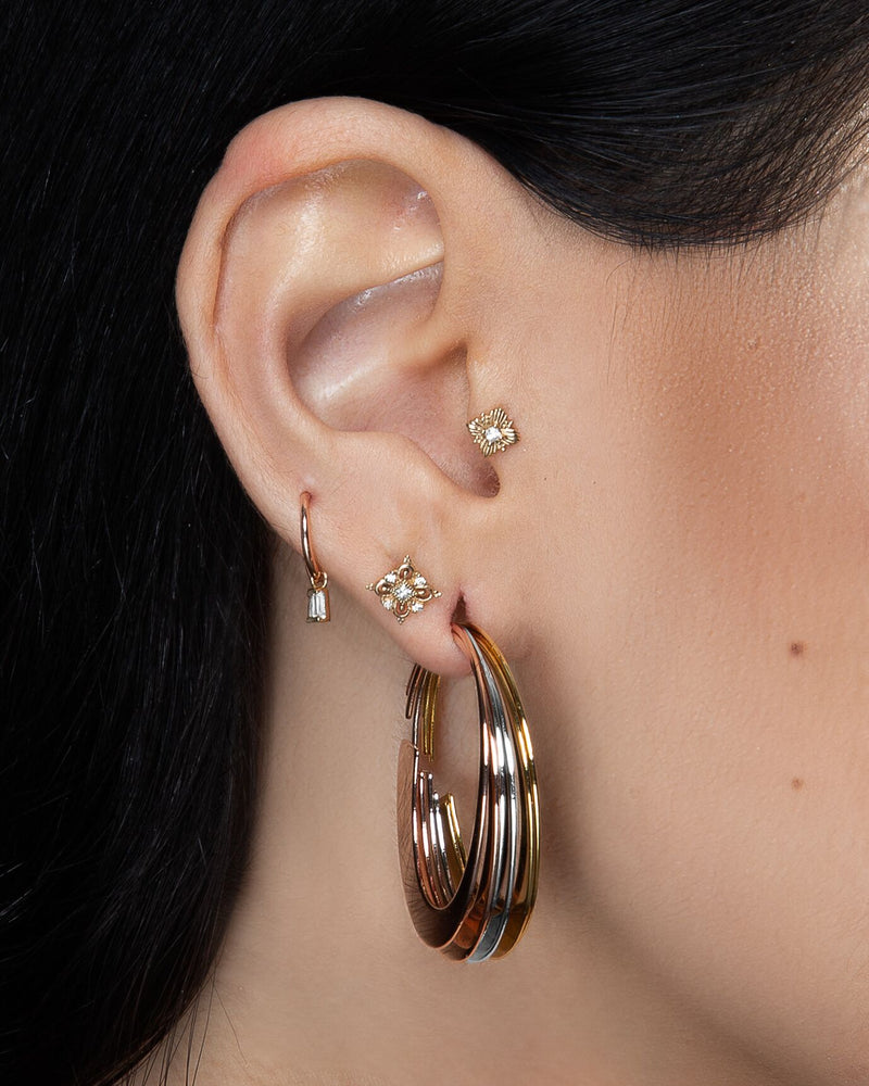 Ear showing charm in piecing