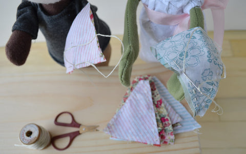 May Day Bunting -- Sewing the triangles together