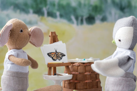 Annicke Mouse and Jeremy Owl look at butterfly painting