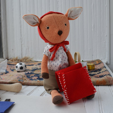 Phoebe Fawn with doll backpack