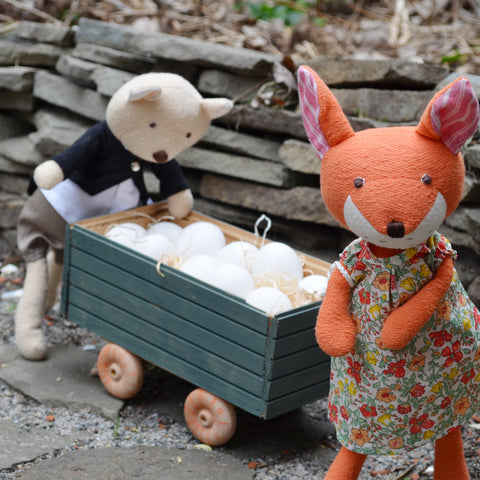 Nicholas and Flora gather eggs in the wagon