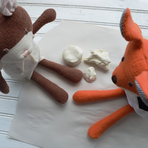 Owen Fox and Juliette Rabbit play with clay
