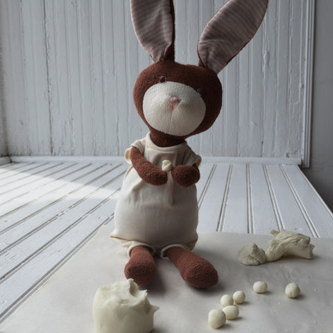 Juliette Rabbit rolls clay into bead shapes
