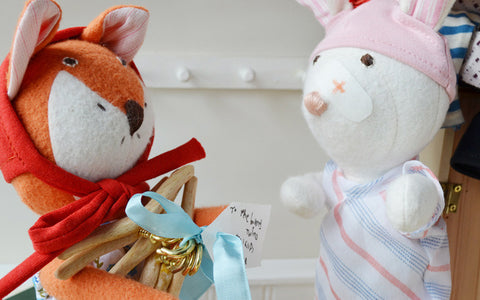 Flora Fox delivering finished wooden hangers to rabbit twins