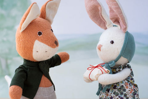 Owen Fox receives a gift from Penelope Rabbit