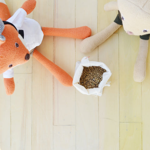 Reginald Fox and Annicke Mouse with bag of seeds