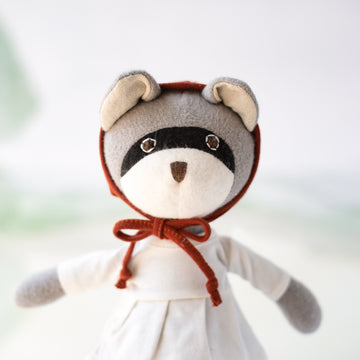 Gwendolyn Raccoon in Ivory Tunic and Red Bonnet