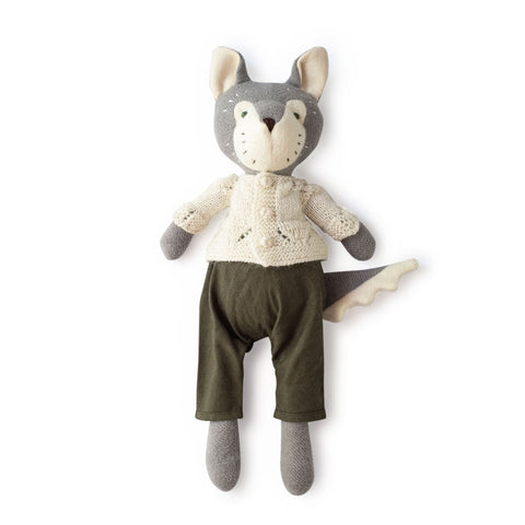 Juniper Wolf in charcoal linen overalls and sweater