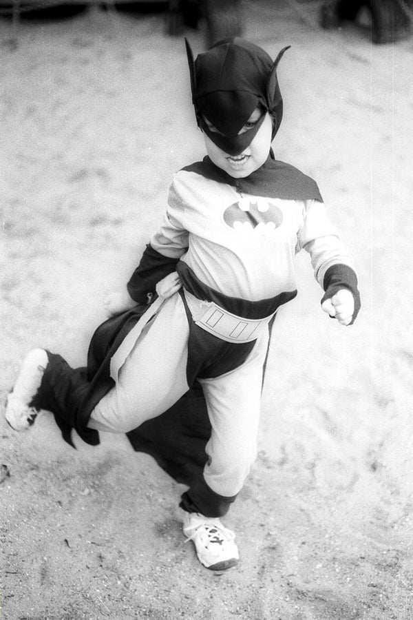 """Batman"" ~ A child in a batman costume dances around."