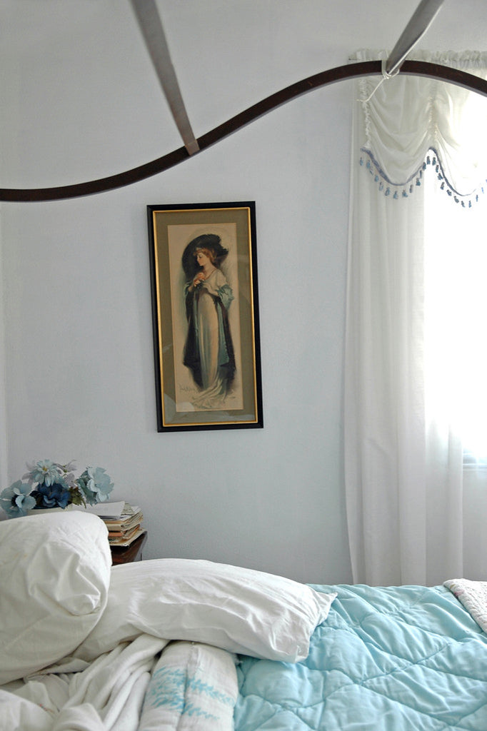 """Blue Flowers"" ~ A section of a bedroom with a canopy bed, a vintage art print on the wall and a bowl of blue flowers in the corner. El Paso, TX"