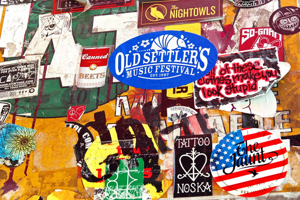 """Canned Beets"" ~ A wall collage of band stickers and ads outside the Continental Club in Austin, TX."