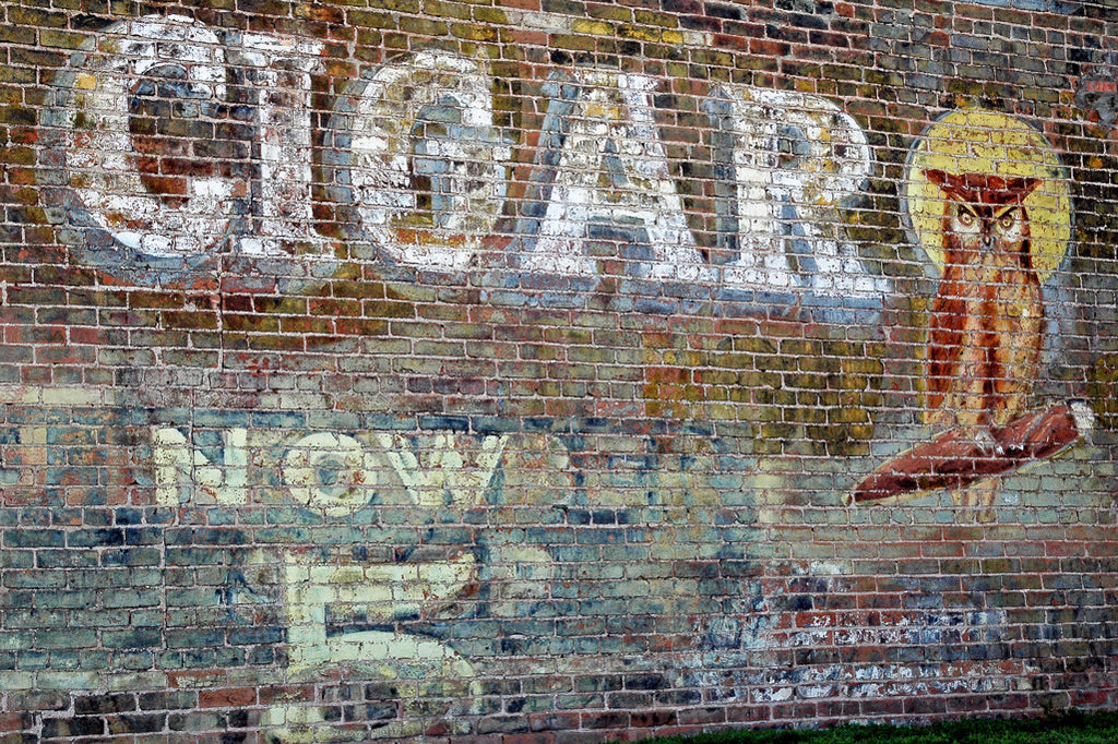 """Cigar Owl"" ~ Vintage cigar sign painted on a brick wall."