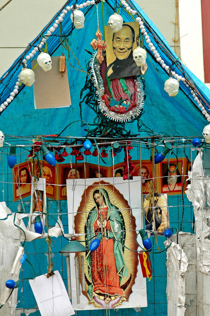 """Dalai Lama"" ~ Close-up of a blue makeshift alter to the Dalai Lama and to the Virgin Mary. Photo by Ann Woodall"