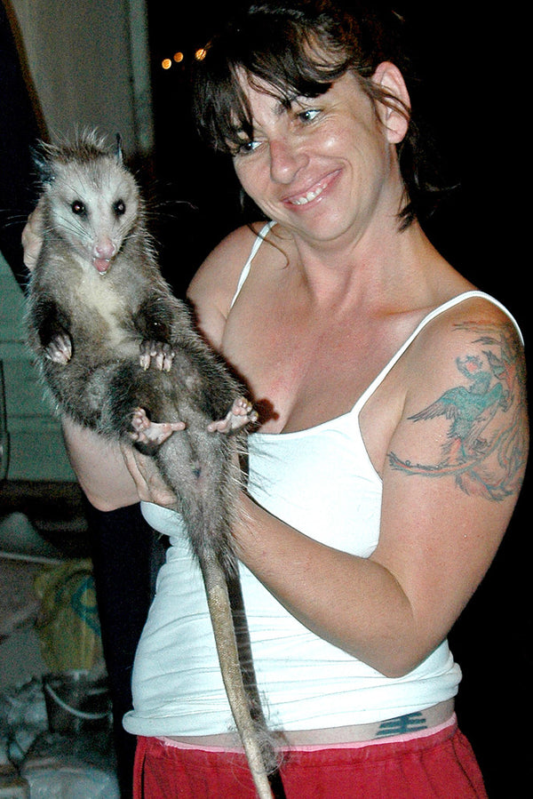 """Docile Opossum"" ~ Woman holds a very calm opossum for a portrait. Photo by Ann Woodall"