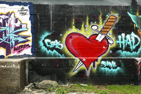 """Heartbreak"" ~ Graffiti of a heart with a knife through it. Photo by Ann Woodall"