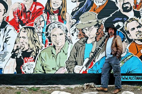 """James McMurtry & Friends"" ~ Musician James McMurtry stands next to his image in a mural by Aaron Sacco in Austin, TX. Photo by Ann Woodall"