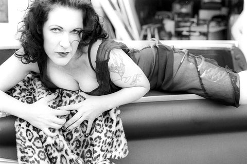 """Linda Lou & the Belvedere"" ~ Pinup style image of Linda Lou draped across a Belvedere car. Photo by Ann Woodall"