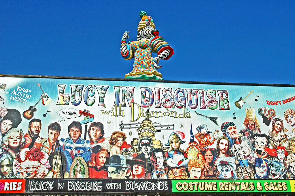 """Lucy In Disguise"" ~ The sign for Lucy In Disguise costume shop in Austin, TX with the Carmen Miranda zebra woman on top. Photo by Ann Woodall"