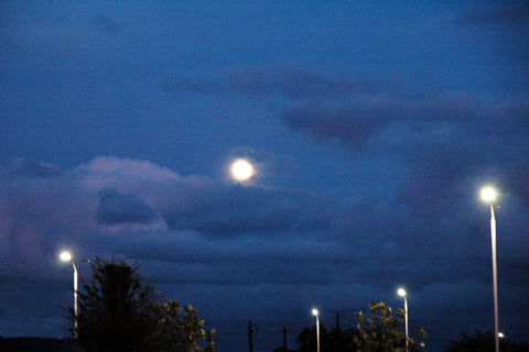 """Moons"" ~ A full moon and moon-like street lights all together. Photo by Ann Woodall"