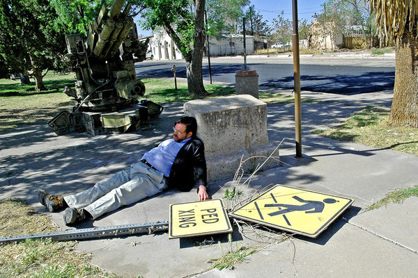 """Ped Xing"" ~ A ped xing sign lies flat on the ground and my uncle John jokingly lies next to it. Photo by Ann Woodall"