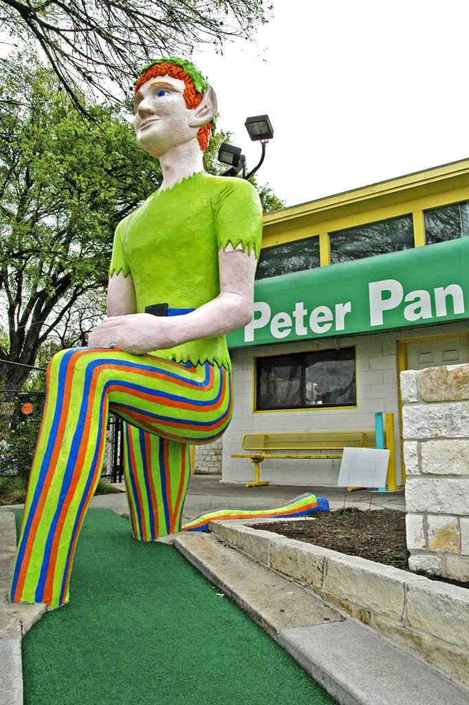 """Peter Pan Golf"" ~ The giant Peter Pan that kneels over a miniature golf course in Austin, TX. Photo by Ann Woodall"