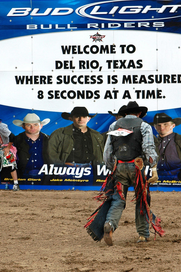 """Success"" ~ Bull riding contestant after a ride in Del Rio, TX. Photo by Ann Woodall"