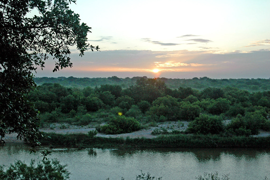 """Sunrise On the Llano"" ~ Sunrise coming up over the Llano River near Mason, TX. Photo by Ann Woodall"