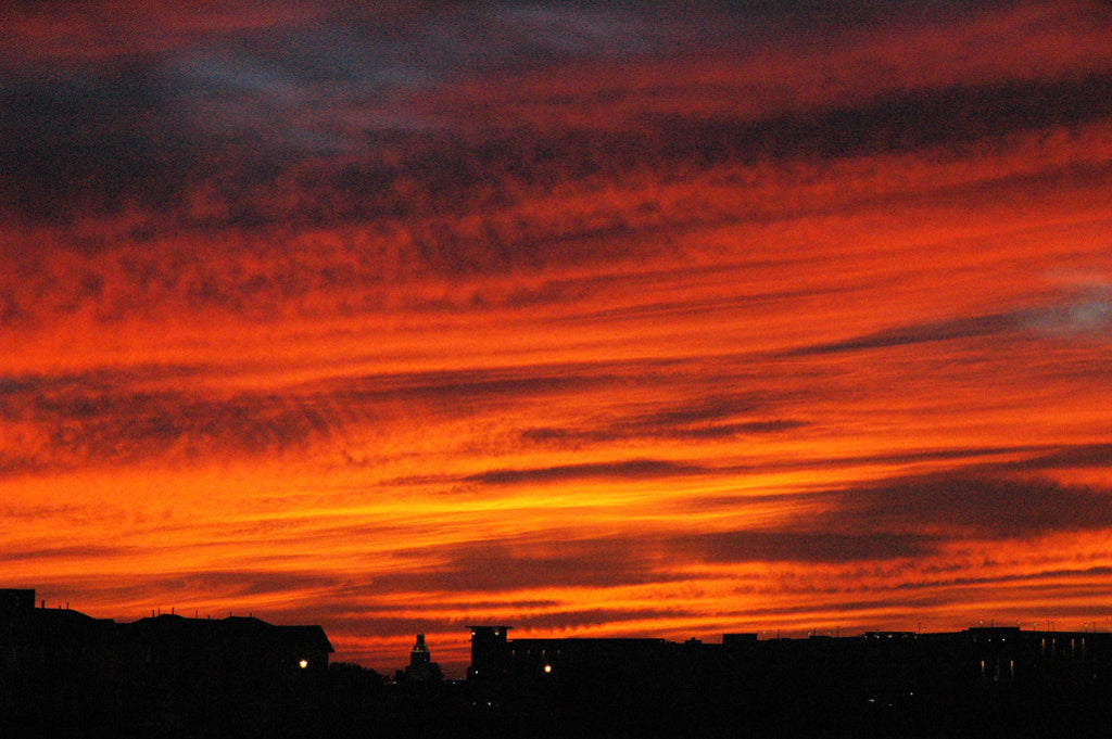 """UT Texas Sunset"" ~ Downtown Austin, TX with a burnt orange sunset behind it. Photo by Ann Woodall"