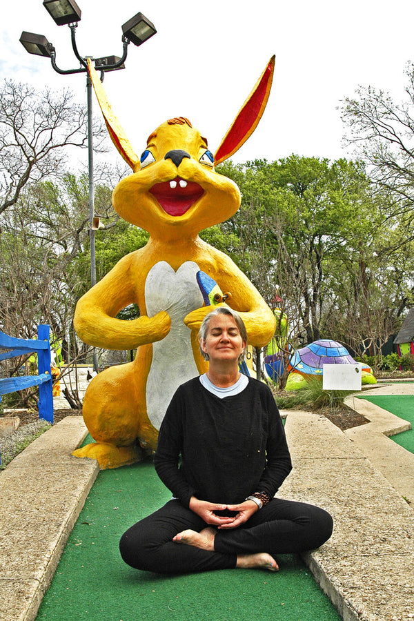 """Yoga Bunnies"" ~ Spike Gillespie meditates with giant rabbit in Austin, TX. Photo by Ann Woodall"