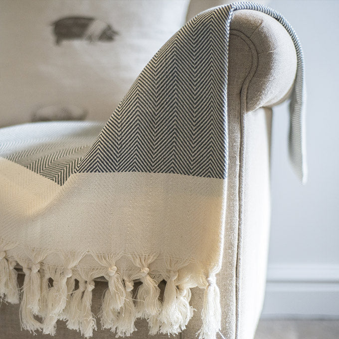 Turkish Hammam towel used as a cosy armchair blanket