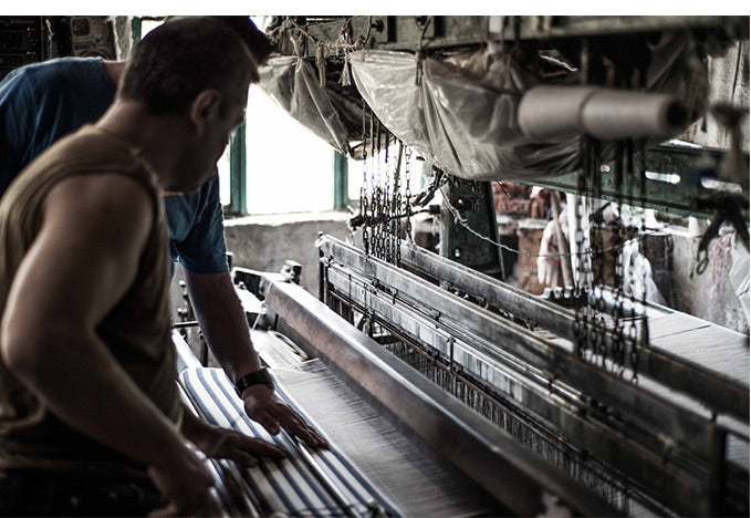 Checking the quality of the turkish towels in the looms
