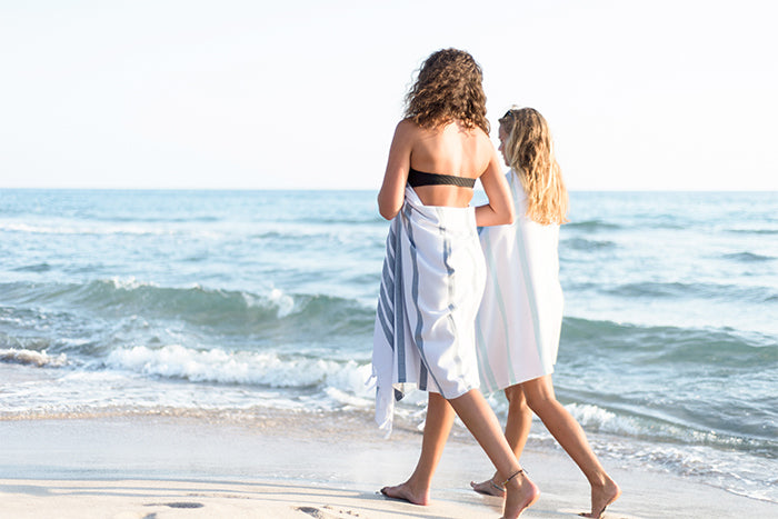 Friends at the beach with their turkish towels