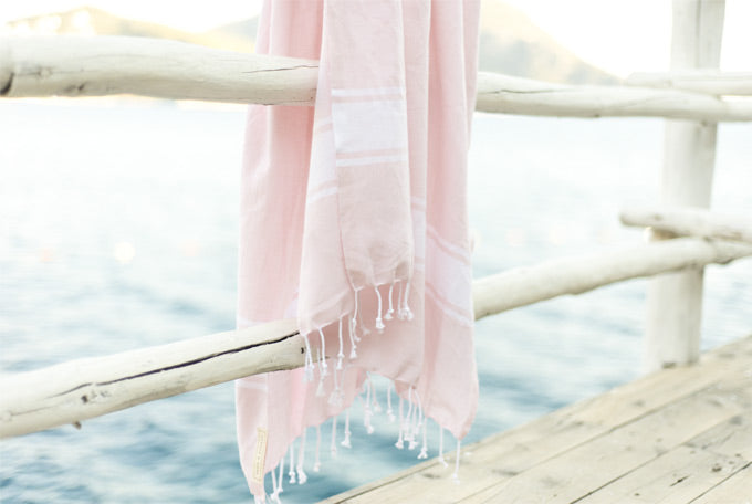 Pale blush pink turkish towel at the beach