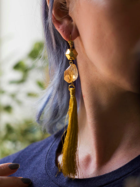 Auxo asymmetric silky tassel golden tone brass earrings